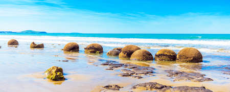Moeraki boulders on Koyokokha beach in the Otago region, New Zealand. Copy space for text