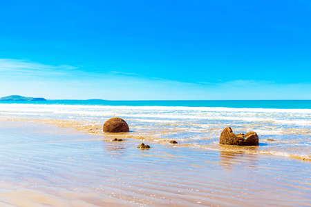 Moeraki boulders on Koyokokha beach in the Otago region, New Zealand. Copy space for text