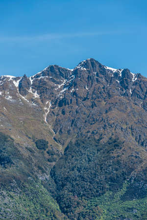 View of the snowy mountain peak against the blue sky, Queenstown, New Zealand. Copy space for text