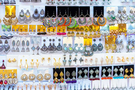 Indian earrings in the local market, Puttaparthi, India