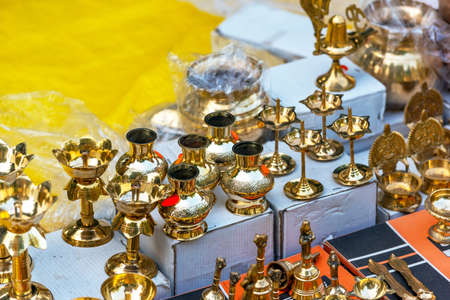 Indian metal souvenirs in the local market, Puttaparthi, India