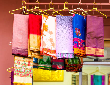 Indian sari in the local market, Puttaparthi, India. With selective focus Stock Photo
