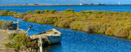 Boat on a Canal in Ebro Delta, panorama view, Tarragona, Catalunya, Spain. Copy space for text