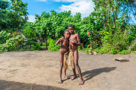TANNA ISLAND, VANUATU - JULY 21, 2019: Boys in loincloths in the village of Yakel Editoriali