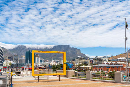 Cape Town, South Africa - January 29, 2020: Yellow frame for making photos of Table Mountain at Cape Town waterfront