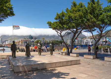 Cape Town, South Africa - January 29, 2020: Bronze statues of the 4 Nobel Peace Prize laureates from South Africa at V&A Waterfront
