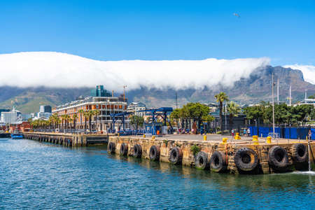 Cape Town, South Africa - January 29, 2020: Table Mountain at the Victoria & Alfred Waterfront. Copy space for text. Copy space for text