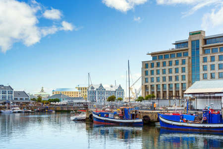 Cape Town, South Africa - January 29, 2020: Boats on the waterfront Victoria & Alfred Waterfront in the city center