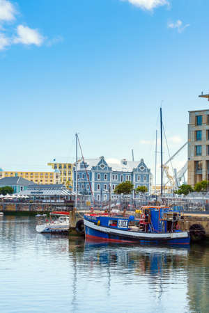 Cape Town, South Africa - January 29, 2020: Boats on the waterfront Victoria & Alfred Waterfront in the city center. Vertical. Copy space for text
