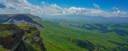 Beautiful Amazing Bermamyt Plateau. Caucasus Elbrus Region in Russia Summer Landscape with green Meadow, Panorama dramatic Sky