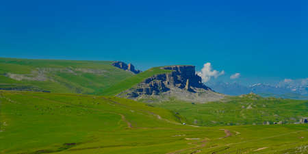 Amazing Elbrus and Green Meadow Hills at a Summer Day. North Caucasus, Karachay-Cherkessia, Russia