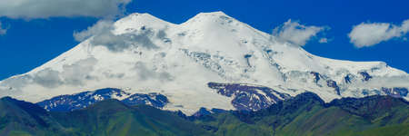Amazing Panorama View Elbrus and Green Meadow Hills at a Summer Day. North Caucasus, Karachay-Cherkessia, Russia