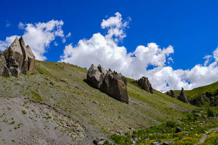 Rock Landscape at the Elbrus Region, with cloudy Sky