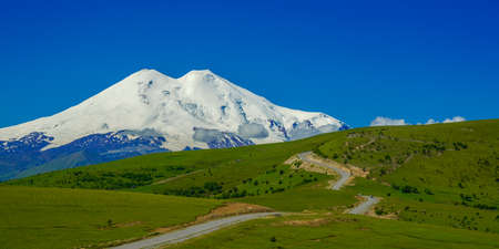 Panorama Road Leading at Hills to Mount Elbrus