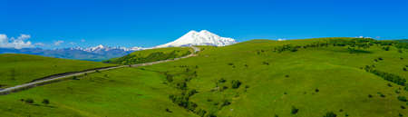 Elbrus and Green Meadow Hills , Panorama, North Caucasus, Russia