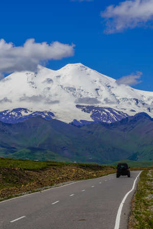 Panorama Road Leading To Mount Elbrus with Car. Stock Photo