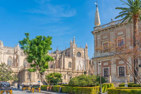 SEVILLE SPAIN, OCTOBER 17. 2020: The Cathedral of Saint Mary of the See, Seville, largest Gothic cathedral, Unesco Word Heritage Site with horse carriage