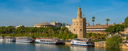 SEVILLE-SPAIN, OCTOBER 18, 2020: Torre del Oro, Seville, Military watchtower erected in order to control access to Seville, Guadalquivir river, pano