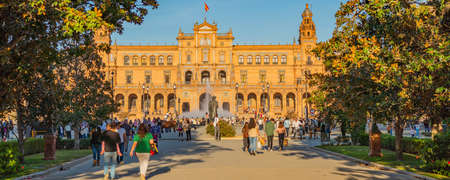 SEVILLE-SPAIN, OCTOBER 18th 2020: Plaza de Espana Spain Square with people walking at sunset time in Beautiful Seville, Andalusia, Spain, panorama Editorial