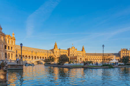 SEVILLE, SPAIN OCTOBER 18. 2020: Plaza de Espana Square at sunset time with Boats on the Canal in Beautiful Seville, Andalusia, Spain Editorial