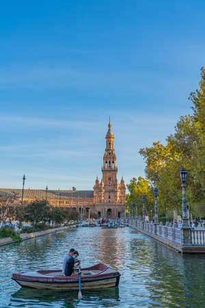SEVILLE-SPAIN, OCTOBER 18th 2020: Plaza de Espana Square with Boats on the Canal in Beautiful Seville Spain vertical