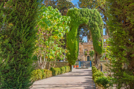 Gardens in historical Reales Alcazares in Seville in Andalusia, Spain