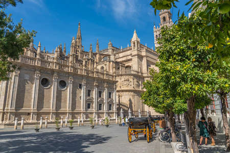 SEVILLE SPAIN, OCTOBER 17. 2020: The Cathedral of Saint Mary of the See, Seville, Gothic cathedral, Unesco Word Heritage Site with horse carriage Editorial