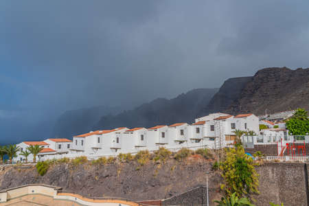 View of Puerto de Santiago with the typical Building, Tenerife, Canary Islands, Spain, background Los Gigantes