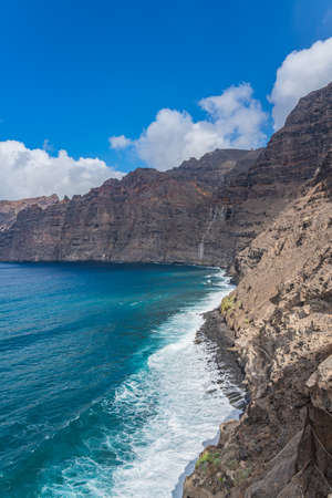 Beautiful view of Los Gigantes cliffs in Tenerife, Canary Islands, Spain. Scenery vertical nature background
