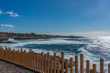 Tropical island of Tenerife. Panorama of the beach on the island of Tenerife. Background blue sky color 免版税图像