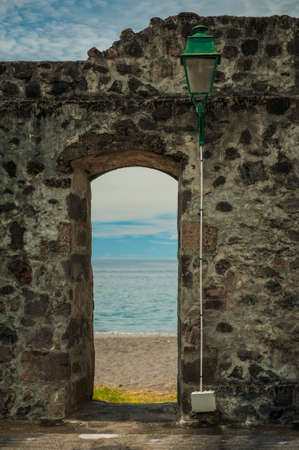 Old Stone doorway and tropical beach