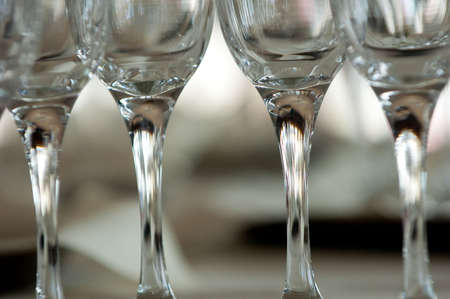 Row of 4 glasses in a table photo