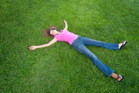 Young Woman relaxing lying on green grass Stock Photo - 5462822