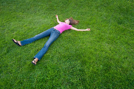 Young Woman relaxing lying on green grass Stock Photo - 5462823