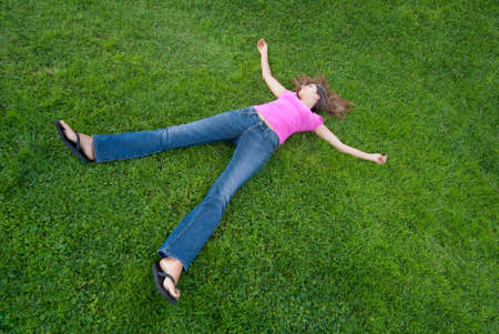 Young Woman relaxing lying on green grass Stock Photo - 5462826