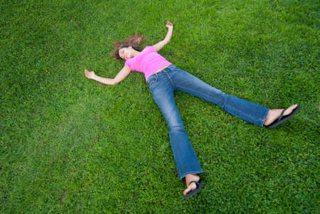 Young Woman relaxing lying on green grass Stock Photo - 5462825