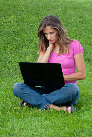 Woman with laptop sit relaxed green grass photo