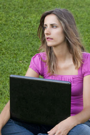 Woman with laptop sit relaxed green grass Stock Photo - 5462827
