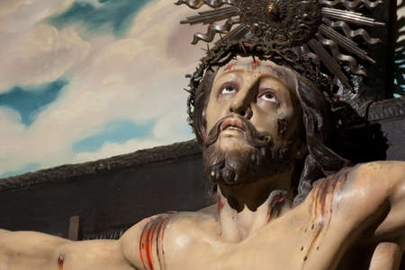 Jesus Christ Cross painting in the background  photo