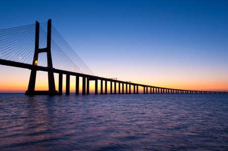 Sunrise at Vasco da Gama bridge Lisbon Portugal Stock Photo - 9019172
