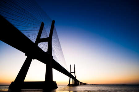 Sunrise at Vasco da Gama bridge Lisbon Portugal photo