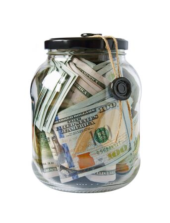 the hundred dollar bills are stuffed in a glass jar with a lid and sealed with sealing wax Isolated on a white background Archivio Fotografico