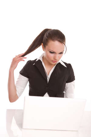 Woman with a laptop thinking Stock Photo - 7042151