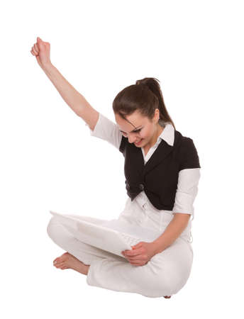 Young Lady with a white laptop raised arm in joy Stock Photo