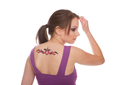 woman with tattoo on her back photo