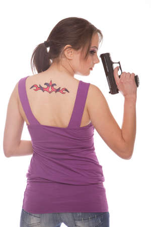 Girl holding a gun with tattoo on her back photo
