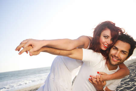 Young Couple at the beach holding hands, look at our light boxes for similar images.