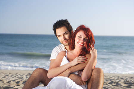 Couple at the beach seducing each other Stock Photo