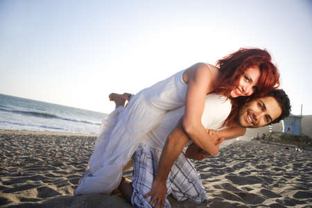 Young Couple at the beach holding each other.