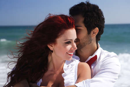 young couple enjoying on the beach Stock Photo